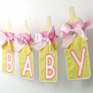 Baby Bottle Banner in the hoop project by Big Dreams Embroidery